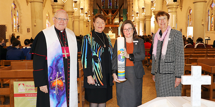 Burning bright: Brisbane Archbishop Mark Coleridge, BCE executive director Pam Betts, Toowoomba Catholic Schools Office chief financial officer Julie Payne and Queensland Catholic Education Commission executive director Dr Lee-Anne Perry.