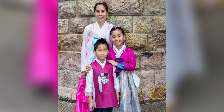 Family: Members of the Korean Catholic Community, Patricia Park with Vincent and Angela Choi.