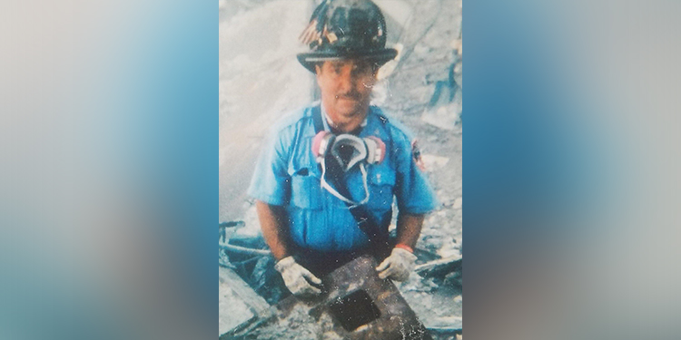Firefighter: Thomas Damore, a retired captain of the New York Fire Department, is pictured at ground zero in 2001.